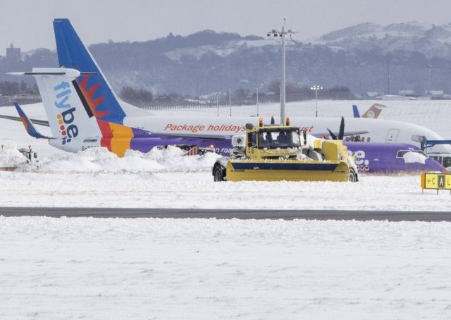 Edinburgh Airport has been badly affected by this week's weather. Picture: SWNS