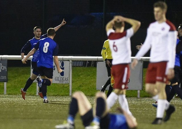 Thomas Orr celebrates his late winner, much to the dismay of the Spartans players at Ainslie Park. Picture: Neil Hanna
