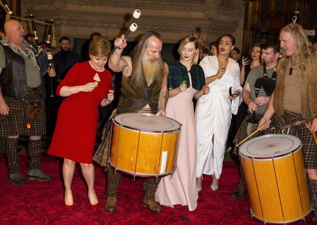 First Minister Nicola Sturgeon and Saoirse Ronan dance with the band as they attend the Scotland premiere of Mary Queen of Scots. Picture: Getty Images