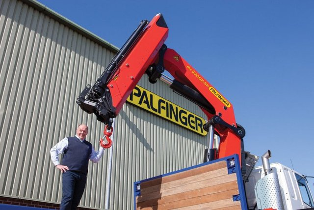 TH White director Mark Rigby with one of the Palfinger UK lorry cranes