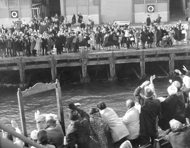 Friends and relatives wave goodbye from the Greenock quayside as Scottish emigrants depart in April 1967. Picture: Gordon Rule/TSPL
