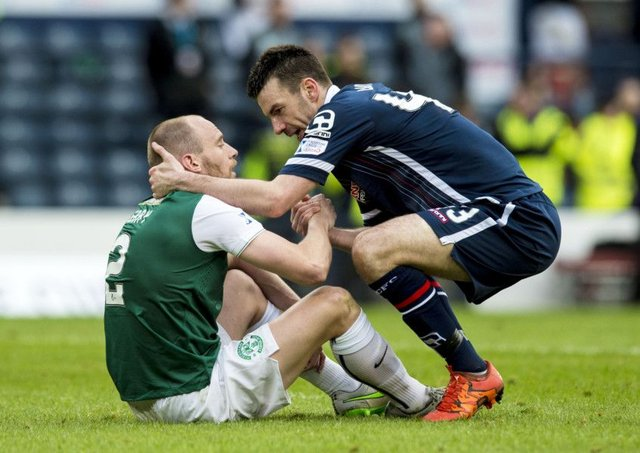 Paul Quinn shakes the hand of Hibs' David Gray at full-time in the League Cup final. Picture: SNS