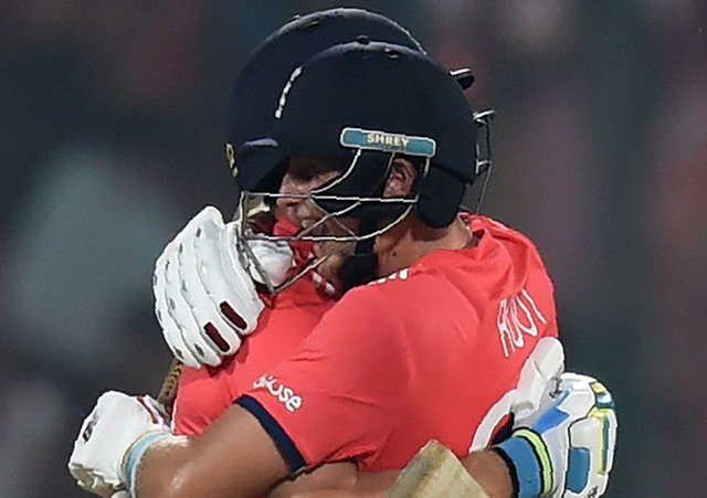 England's Jos Buttler, left, and Joe Root celebrate after winning their World T20 semi-final against New Zealand. Picture: Money Sharma/AFP/Getty