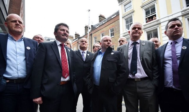 Steelworkers arrive for yesterdays crisis meeting in London. Picture: AFP/Getty