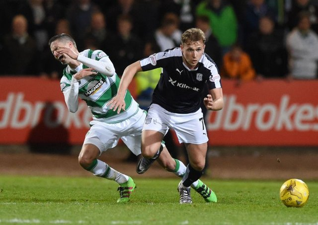 Celtic's Mikael Lustig (left) battles for the ball against Dundee's Greg Stewart. Picture: SNS