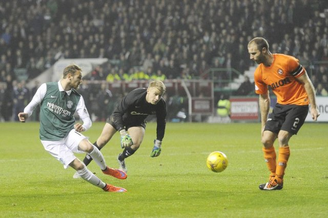 Martin Boyle and Sean Dillon face off in the League Cup match at Easter Road earlier this season. Picture: Greg Macvean