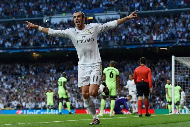 Gareth Bale celebrates after his shot was diverted into the Manchester City net in the Champions League semi-final, second leg at the Santiago Bernabeu. Picture David Ramos/Getty Images