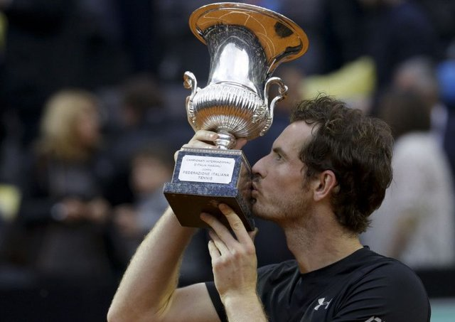 Andy Murray kisses the trophy after beating Novak Djokovic 6-3, 6-3 in the final match of the Italian Open. Picture: AP
