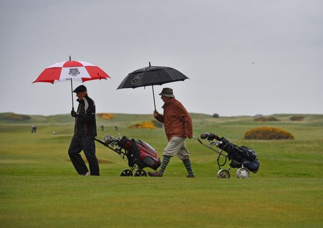 Men play golf at Muirfield Golf Club where they rejected the decision on women as members. Picture: Getty