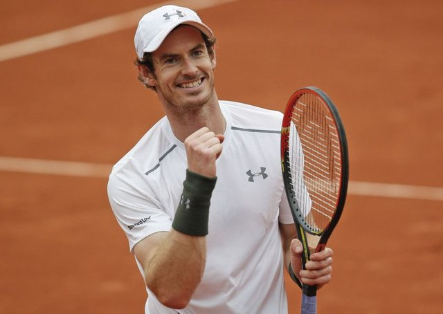 Andy Murray celebrates winning his quarter final match against France's Richard Gasquet. Picture: AP