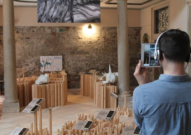 A visitor to the Scotland exhibit in Venice uses the augmented reality technology