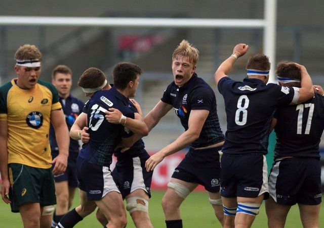 Scotland's Andrew Davidson, centre, celebrates after his side's victory over Australia during the World Rugby U20 Championship. Picture: Clint Hughes/Getty