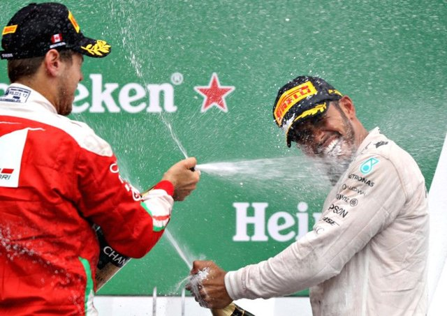 Canadian Grand Prix winner Lewis Hamilton is sprayed with champagne by Sebastian Vettel. Picture: Getty Images