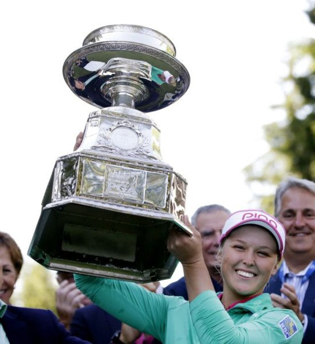 Brooke Henderson holds aloft the tropht after her play-off win over Lydia Ko. Picture: AP