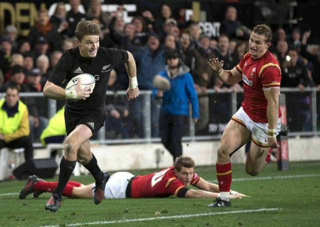 New Zealand's Beauden Barrett runs in for his second try against Wales.  Picture: Brett Phibbs/New Zealand Herald via AP