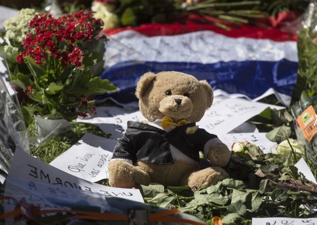 Five arrested following truck tragedy in Nice as memorials continue to be laid. Picture: AP Photo/Laurent Cipriani