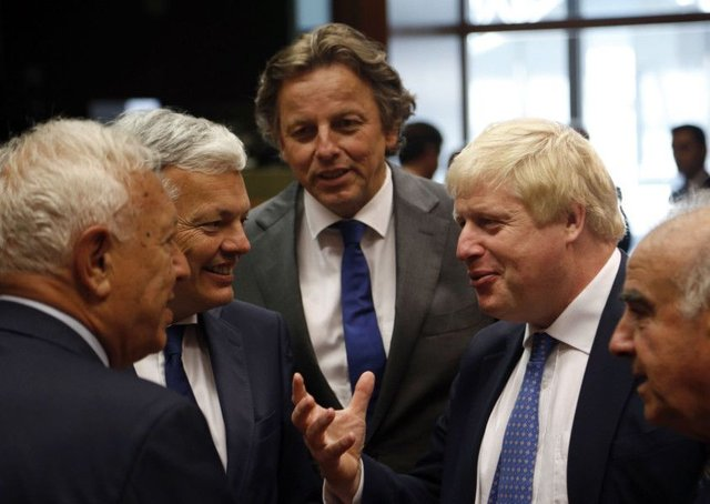 Foreign Secretary Boris Johnson, second from right, speaks with other ministers before Monday's meeting. Picture: AP