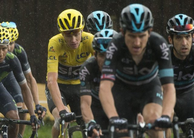 Job nearly done for Chris Froome as his trusted team-mates, led by Geraint Thomas, surround him during the penultimate stage. Picture: Peter Dejong/AP
