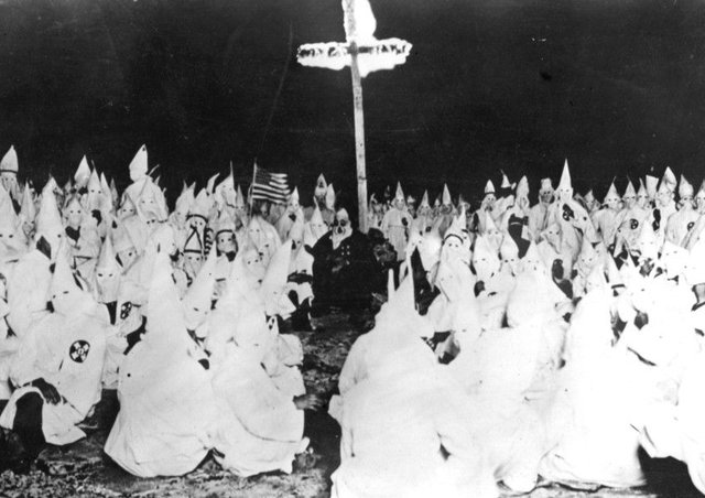 November 1922:  A midnight meeting of the American white supremicist movement, the Ku Klux Klan.  (Photo by Topical Press Agency/Getty Images)