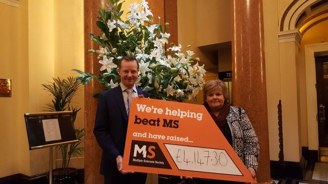 Steve Hall from The Dome presents a cheque to Moira Simpkins of MS Society Scotland. Picture: Contributed