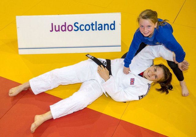 Malin Wilson joins pupil Alexis Faulds from Dalmarnock Primary School to launch the European Judo Open. Picture: Alan Harvey/SNS