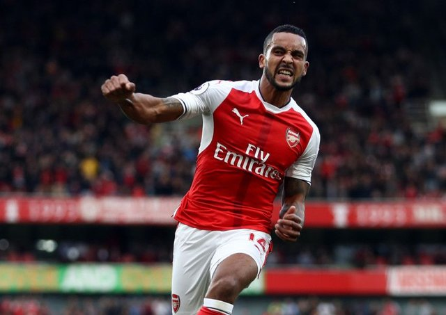 Theo Walcott celebrates scoring against Swansea City. Picture: Getty