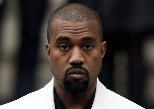 Kanye West has reportedly been admitted to hospital for exhaustion, a day after cancelling his tour. Picture: PA