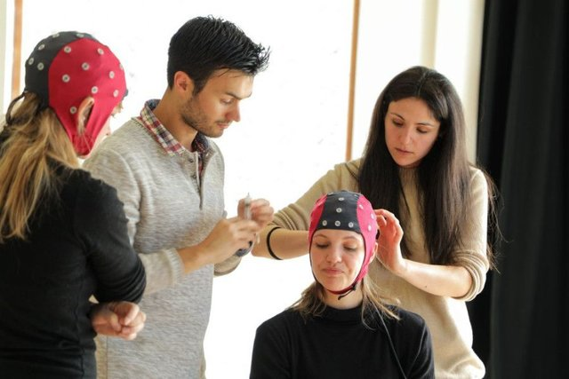 Simon Ladouce, researcher at Stirlings centre for mobile cognition, sets up an electrode cap on a dancer. Picture: Contributed