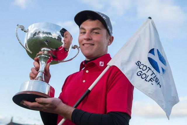 John Paterson poses with the trophy after winning the Scottish Boys Open Stroke-Play Championship. Picture: Kenny Smith