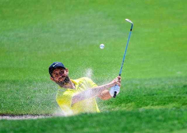 France's Alexander Levy plays out of a bunker on his way to the first-round lead at the China Open in Beijing. Picture: AFP/Getty Images
