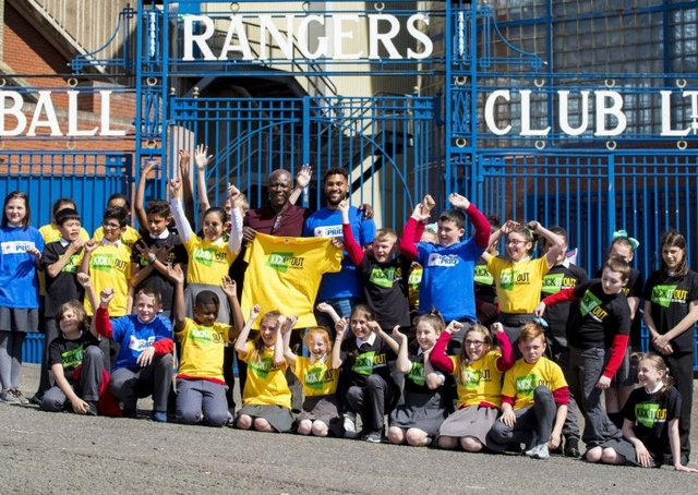 Wes Foderingham and Paul Mortimer with pupils of St Saviours Primary School, where Kick it Out held an anti-discrimination workshop.