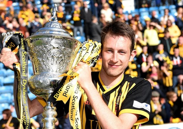 Dwayne Hislop celebrates Auchinlecks victory over Musselburgh in the 2015 final. Photograph: Craig Williamson/SNS