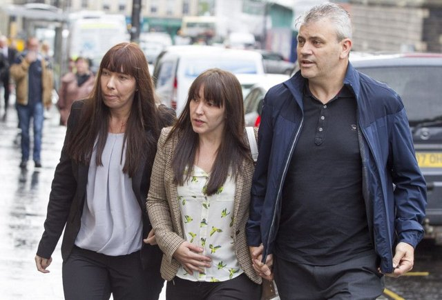 Abbie Wallis(centre) the mother of Keane Wallis-Bennett arrives with her partner James Glendinning at Edinburgh Sheriff Court for the FAI into death of her daughter when a wall collapsed on her at Liberton High School, Edinburgh in April 2014.