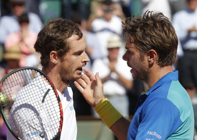 Switzerland's Stan Wawrinka, right, with Andy Murray after their semi-final at Roland Garros. Picture: Michel Euler/AP