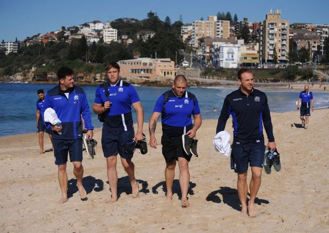 From left: Duncan Taylor, Jonny Gray, Gordon Reid and Greig Tonks walk along Coogee beach near Sydney ahead of tomorrow's Test against Australia. Picture: Fotosport/David Gibson