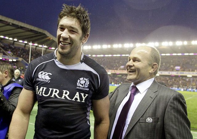 Scotland's Nathan Hines and head coach Andy Robinson celebrate after their 21-17 victory over South Africa at Murrayfield. Picture: GRAHAM STUART/AFP/Getty Images