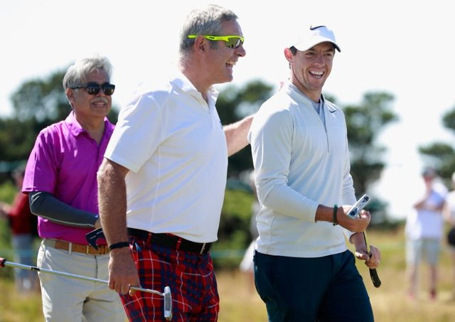 Rory McIlroy shares a joke with Gavin Hastings during the pro-am ahead of the AAM Scottish Open at Dundonald Links.  Picture: Gregory Shamus/Getty Images