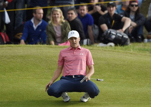 Jordan Spieth looks on in disbelief as his eagle putt on the 15th goes long. Photograph: Ian Rutherford