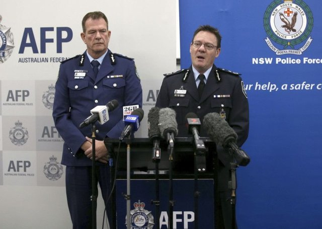 Australian Federal Police Deputy Commissioner Michael Phelan, right, and New South Wales state Police Deputy Commissioner David Hudson discuss details of the charging of two men with terrorism offenses in Sydney. Picture; AP