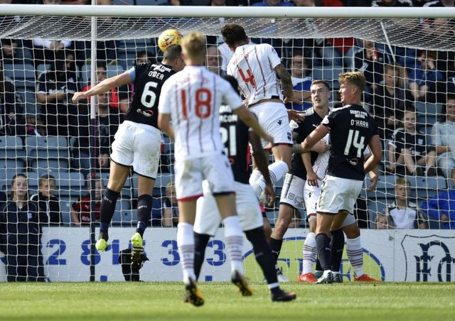 Ross County's Christopher Routis scores to make it 2-0. Picture: SNS/Rob Casey