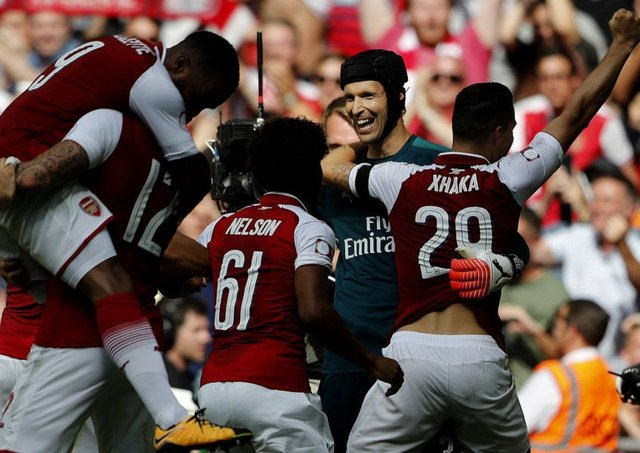 Arsenal striker Olivier Giroud, second from left, celebrates after scoring the decisive penalty to win the Community Shield. Picture: AP.