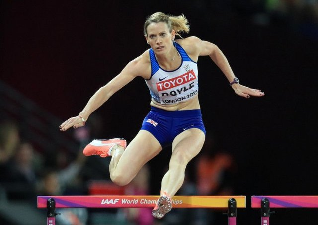 Eilidh Doyle clears a barrier on her way to third place in her 400m hurdles semi-final and qualification for the final as a fastest loser. Picture: Adam Davy/PA Wire