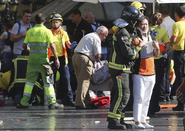 Injured people are treated in Barcelona after yesterday's attack on Las Ramblas. Picture: AP