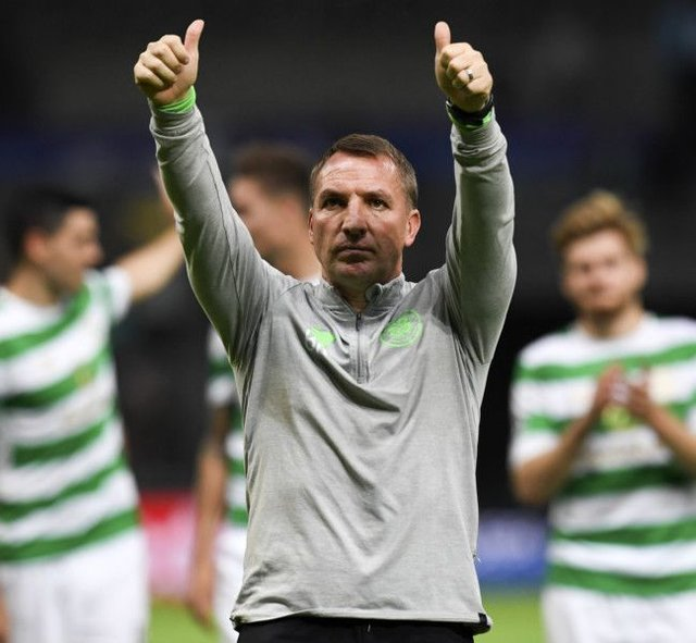 Brendan Rodgers salutes Celtic fans after the 4-3 defeat at Astana. Picture: SNS.