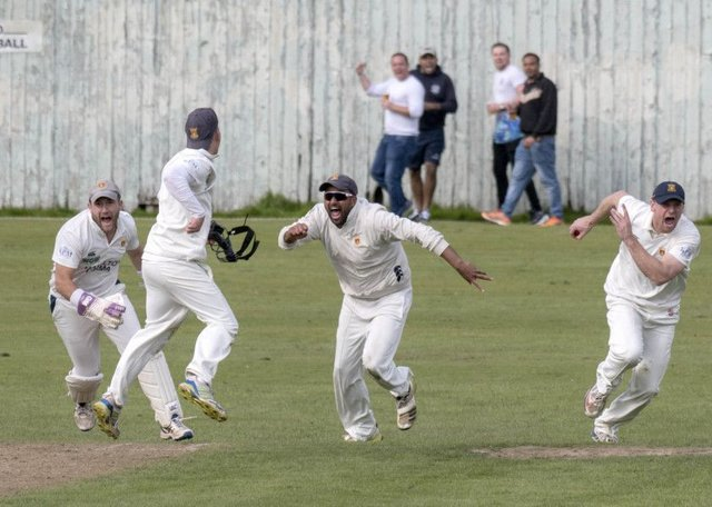 Prestwicks Fraser McDonald, Tom Fleet (back to camera), Shazad Rafiq and Ross Paterson celebrate the wicket of Heriots Mark Watt.  Photograph: Donald MacLeod