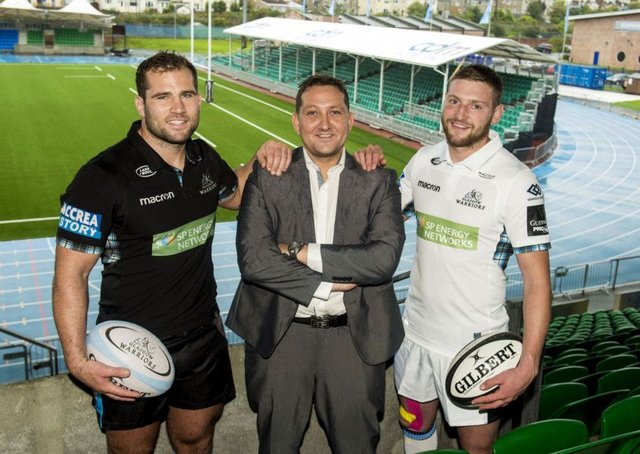 Finn Russell, right,with team-mate Fraser Brown, left, and Mark Cook, managing director of CDM, new sponsor of the east stand. Pictgure: SNS/SRU.