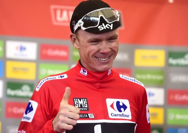 Chris Froome smiles as he sports the overall leaders red jersey after finishing third on the 20th stage of the Vuelta at Alto de LAngliru. Photograph: Jose jordan/AFP/Getty