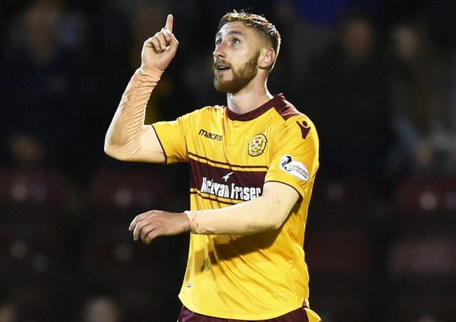 Motherwell's Louis Moult celebrates scoring the third goal against Aberdeen. Picture: Rob Casey/SNS