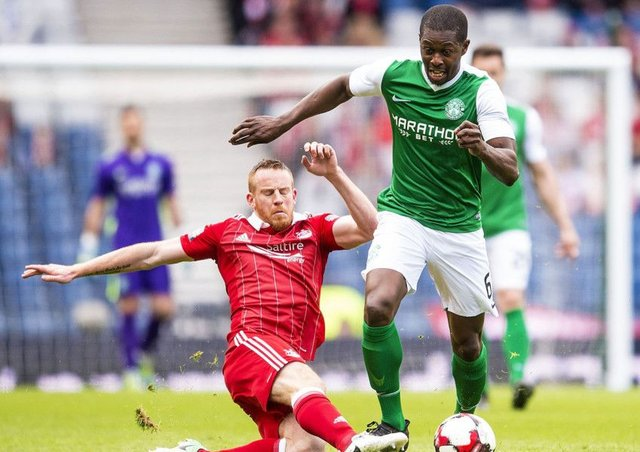 Aberdeen got the better of Hibs in last season's Scottish Cup semi-final. Marvin Bartley is tackled by Adam Rooney. Picture: Bill Murray/SNS