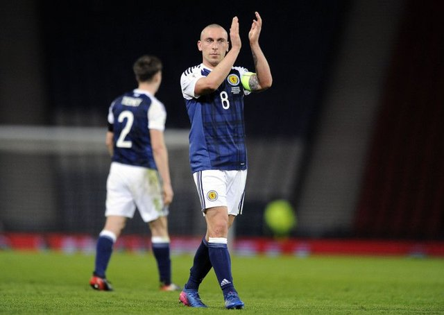 Scott Brown salutes the Scotland fans after the victory over Slovenia in March at Hampden. Picture: Michael Gillen